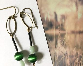 Asymmetrical earrings and delicate Elise