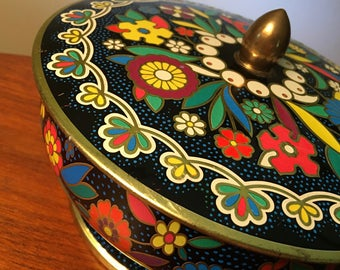 Vintage colorful tin container
