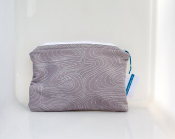 makeup bag, lined pouch, lined makeup pouch, plastic lined bag, zippered bag, zippered pouch, zippered makeup bag