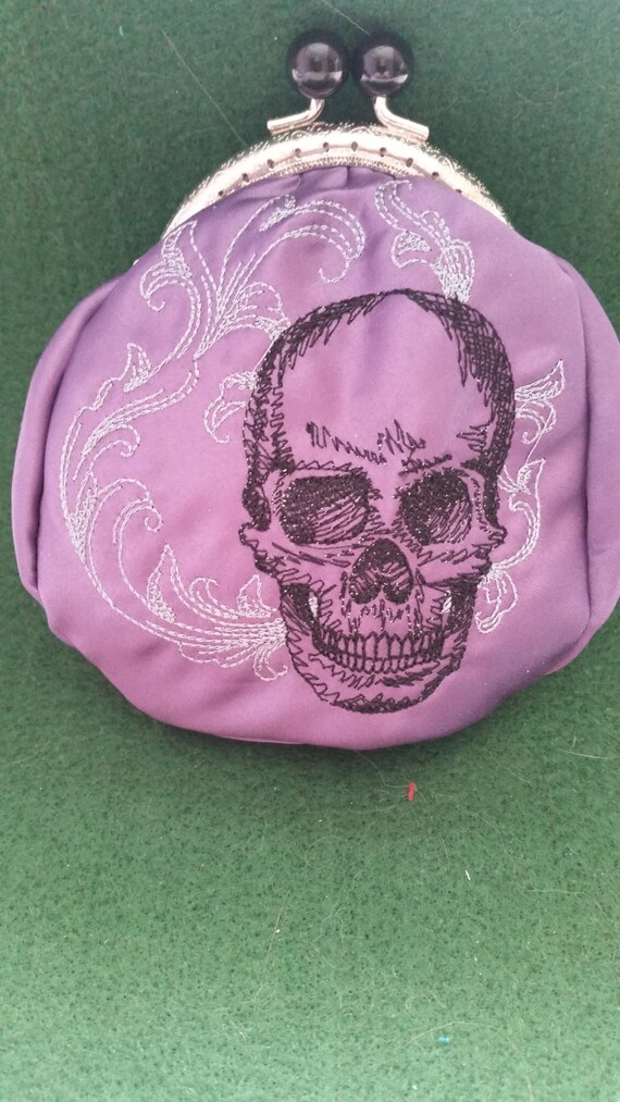 L209.  Coin purse.  Baroque skull design
