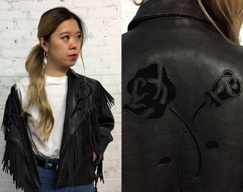 vintage black leather motorcycle jacket / moto jacket with fringe and rose detail