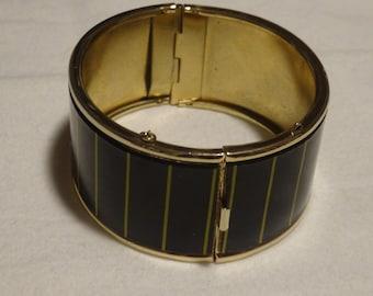 Black and Gold clasp arm bracelet