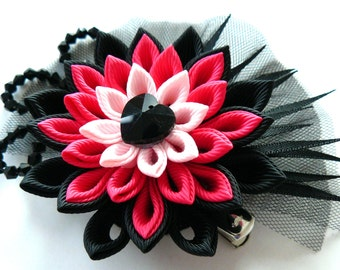 Kanzashi fabric flower hair clip. Black and pink.