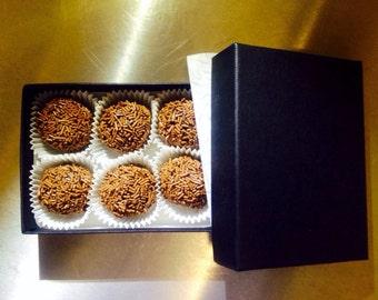 Six chocolate truffles (champagne or rum)