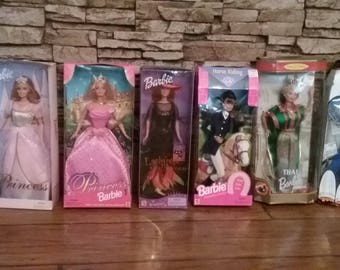 7 Barbies for sale