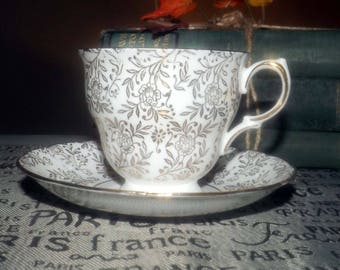 Mid-century (c.1950s) Queen Anne | Ridgway Potteries gold floral chintz tea set (footed cup w/matching saucer). Scalloped gold edge, accents