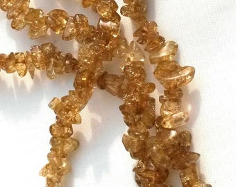 100 chips shiny brown glass beads different sizes