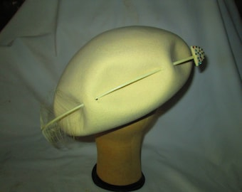 Stunning Ivory Tam Style Hat Pierced with an Arrow and feather Rhinestones Tom Hann Studios