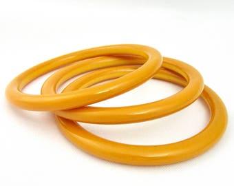 Set of three Bracelets of egg yellow bakelite Bangle