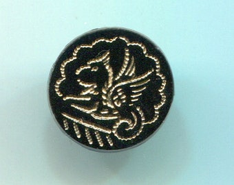 Antique Black Glass Button picturing a Fabulous Creature
