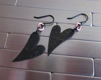 Asymmetric Black Heart Earrings.