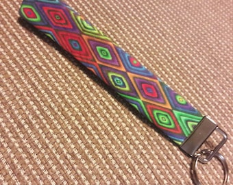 Multi colored triangle fabric key chain fob key chain wristlet