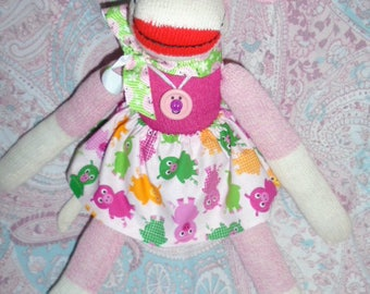Pink Sock Monkey Girl Doll Dressed In Pig Skirt With Matching Sweater And Ribbon
