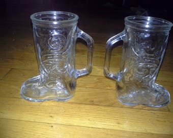 pair of glass embossed cowboy boots drinking mugs