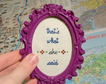 That's What She Said Mini -- Dark Blue cross stitch with flower motif in your choice of ornate frame or wood hoop