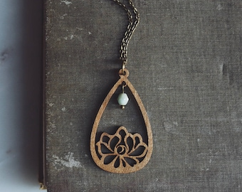 serenity. a bohemian wooden floral teardrop necklace.