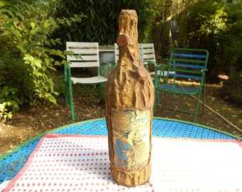 Bottle of cider of Normandy, decorated by hand.