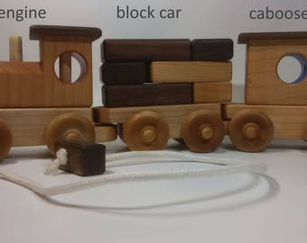 Three-in-one Wooden toy train set by Bruce HAY. All natural wood.