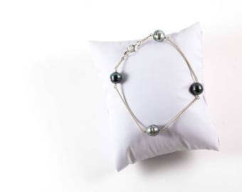 Silver bracelet with 4 pearls threaded (#)