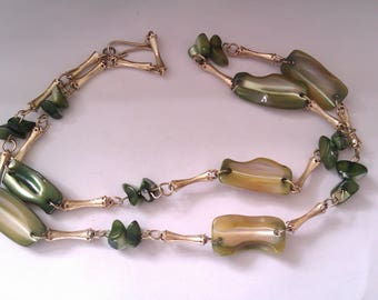 gold coloured metal necklace with green mother of pearl shell beads