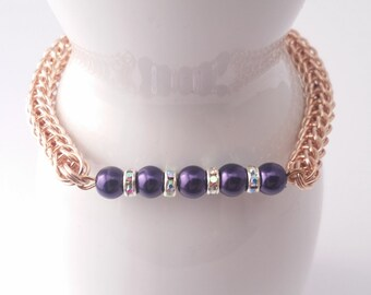 Purple pearl and rose gold chain maille bracelet with rondelle spacers with full persian chain maille weave.