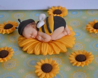 Sleeping baby bee cake topper with  sunflowers