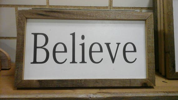 Believe sign with barnwood frame