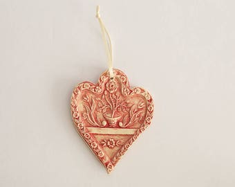 Ceramic heart red enamel, decorated with flowers in relief