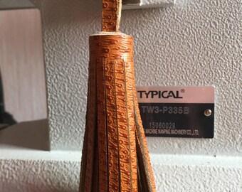 Camel textured leather tassel keychain