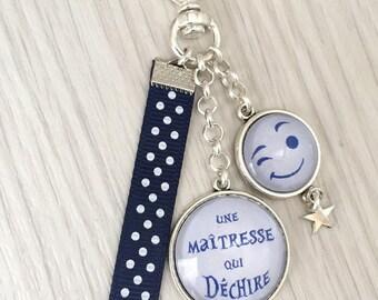 porte-clés bijou de sac a message thème  une maîtresse qui déchire.REF.110