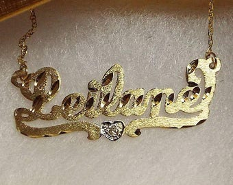 name necklace .   14k .chain sold separatly