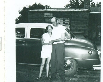 1960s Happy Couple Tall Man Wife Standing Outside Car Parents 60s Vintage Photograph Black White Photo
