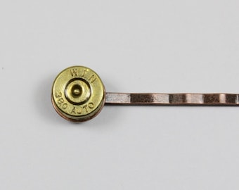 Winchester 380 Auto Bullet Slice Bobby Pin: Brass Bullet Slice with Primer on an Antique Brass Bobby Pin.