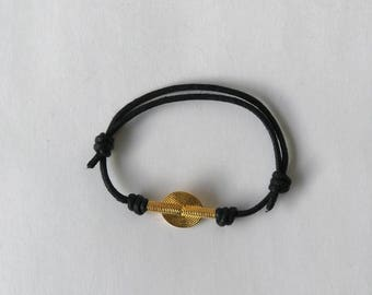 Black cord bracelet with a vermeil bead.