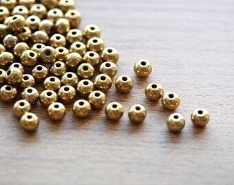 50 pcs of Antique Golden Tibetan Silver Beads - Round - 5mm
