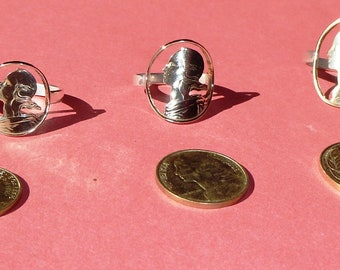 Ring with cut coin