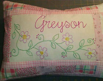 Personalized, hand-embroidered pillows