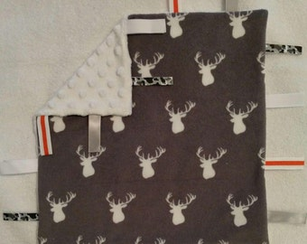 Deer security blanket with ribbons