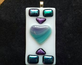 Unique fused and dichroic glass pendant.
