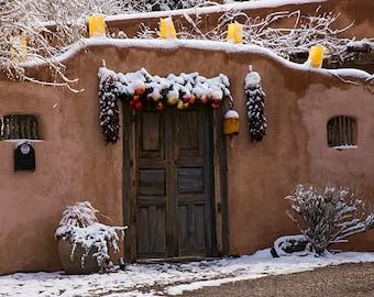 Santa Fe Door and Adobe wall with Snow at Christmas