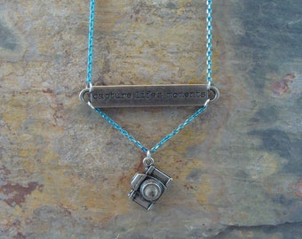"""Uplifting message necklace """"capture life's moments"""" with camera charm & turquoise and gold tone chain"""