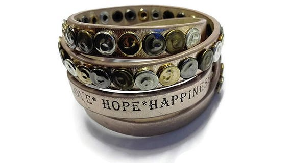 Wrapped faux leather studded bracelet with message