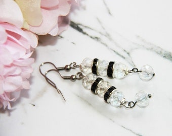 Dangling earrings with black swarovski crystal beads and clear earring