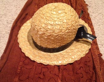 Womans straw hat size medium with black ribbon bow
