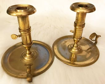Vintage pair brass candlestick holders adjustable height chamber finger hold patina