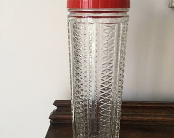 Antique Bartender Shaker, Mixer, made from pressed glass, heavy and tall.  Shows recipes for 5 drinks on top of shaker.  Top rotates