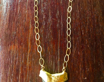 Gold shark tooth choker