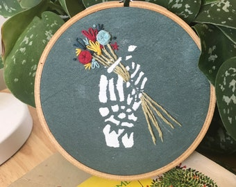 Skeleton Hand with Flowers Hoop