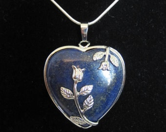 Heart shaped Lapis Lazuli real fluorescing stone and silver pendant with free 18 inch 925 stamped silver snake chain.