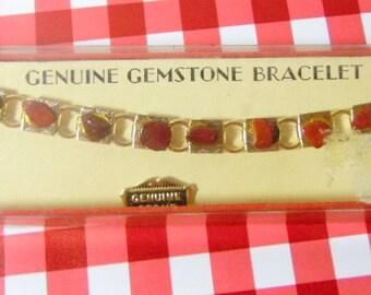 Nice vintage, gold-tone link bracelet.  Each link has a reddish brown stone on it.